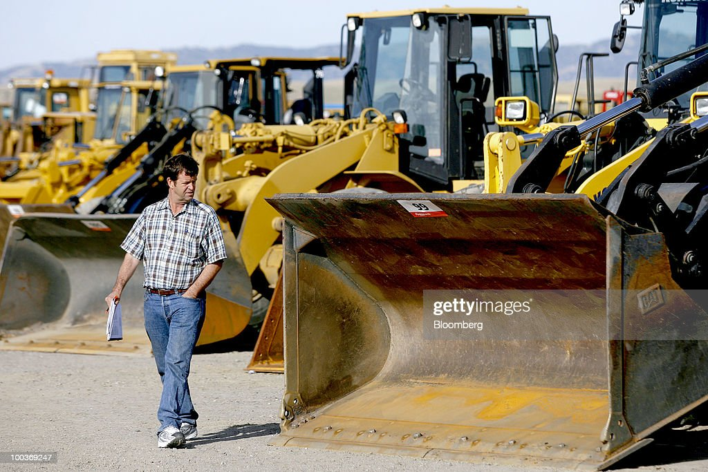 Mitch Logsdon looks at Caterpillar Inc. wheel loaders before a Ritchie Bros. Auctioneers Inc. industrial equipment auction in Dunnigan, California, U.S., on Thursday, May 20, 2010. More than 1,400 lots were offered during the multi-million dollar unreserved public auction through Ritchie Bros., the world's biggest auctioneer of industrial equipment. Photographer: Ken James/Bloomberg via Getty Images