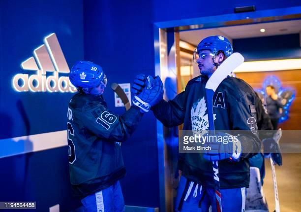 Mitch Marner and Auston Matthews of the Toronto Maple Leafs wear jerseys honouring the Canadian Armed Forces during warmup before facing the Chicago...