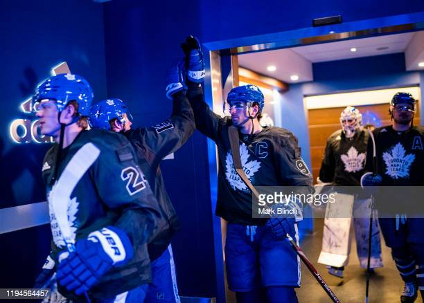 Mitch Marner and John Tavares of the Toronto Maple Leafs wear jerseys honouring the Canadian Armed Forces during warmup before facing the Chicago...