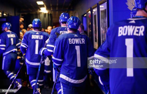 Mitch Marner of the Toronto Maple Leafs and teammates head to the ice for warmup wearing jersey's honouring Leafs legend Johnny Bower during the...