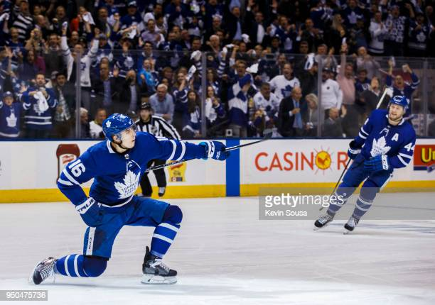 Mitch Marner of the Toronto Maple Leafs celebrates his goal on the Boston Bruins with teammate Morgan Rielly of the Toronto Maple Leafs in Game Six...
