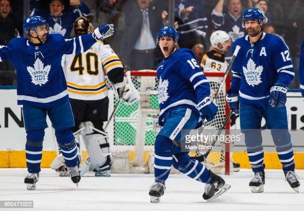 Mitch Marner of the Toronto Maple Leafs celebrates his goal on Tuukka Rask of the Boston Bruins with teammates Tomas Plekanec and Patrick Marleau in...