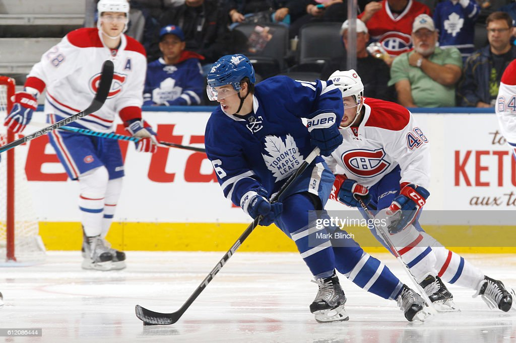 Mitch Marner #16 of the Toronto Maple Leafs is pursued by Daniel Audette #48 of the Montreal Canadiens during the second period of their NHL preseason game at the Air Canada Centre on October 2, 2016 in Toronto, ON, Canada.