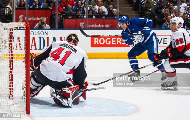 Mitch Marner of the Toronto Maple Leafs scores his 100th NHL point on Craig Anderson of the Ottawa Senators as his teammate Matt Duchene follows the...