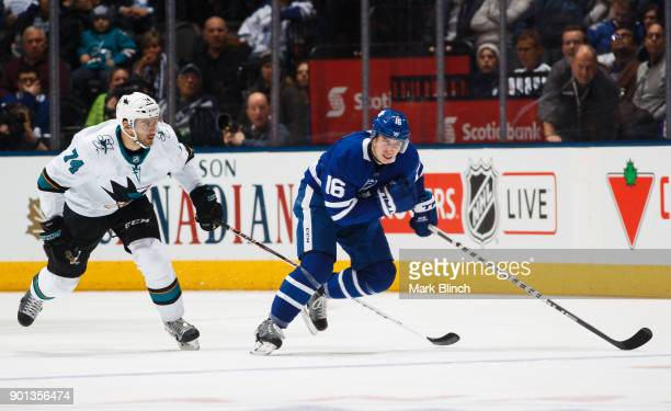 Mitch Marner of the Toronto Maple Leafs skates against Dylan DeMelo of the San Jose Sharks during the third period at the Air Canada Centre on...
