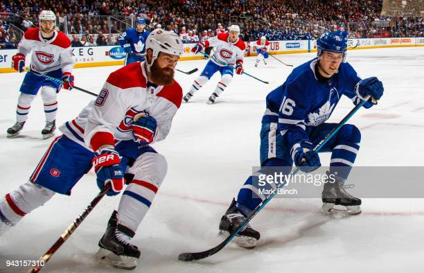 Mitch Marner of the Toronto Maple Leafs skates against Jordie Benn of the Montreal Canadiens during the first period at the Air Canada Centre on...