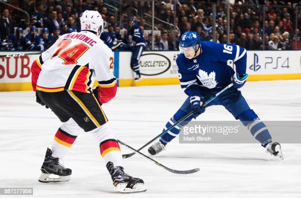 Mitch Marner of the Toronto Maple Leafs skates against Travis Hamonic of the Calgary Flames during the first period at the Air Canada Centre on...