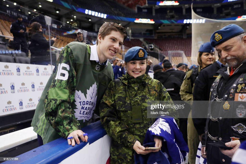 Mitch Marner #16 of the Toronto Maple Leafs stands with members of the Canadian Armed Forces at the Air Canada Centre on February 10, 2018 in Toronto, Ontario, Canada.