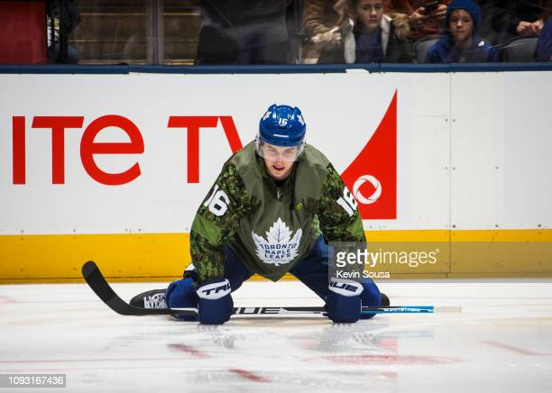 580809340 Mitch Marner of the Toronto Maple Leafs stretches while wearing a  camouflage jersey to honour the
