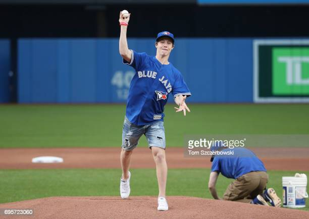 Mitch Marner of the Toronto Maple Leafs throws out the first pitch before the start of the Toronto Blue Jays MLB game against the Tampa Bay Rays at...