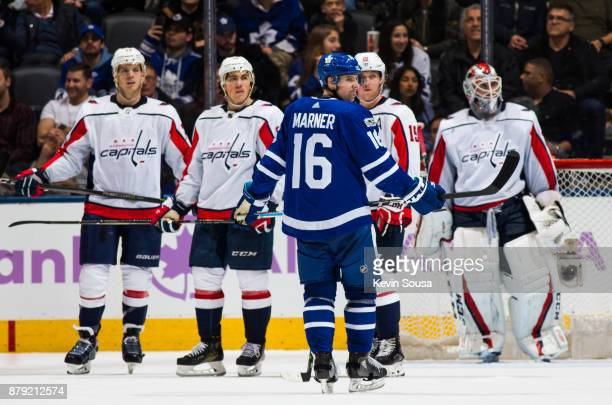 Mitch Marner of the Toronto Maple Leafs waits for his line mates for a faceoff as John Carlson of the Washington Capitals and his teammates TJ Oshie...