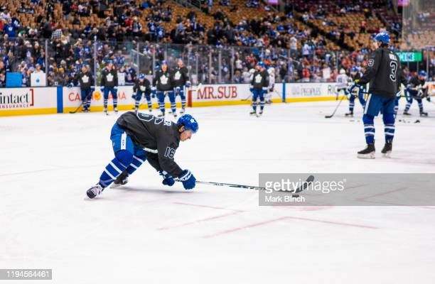 Mitch Marner of the Toronto Maple Leafs wear jerseys honouring the Canadian Armed Forces during warmup before facing the Chicago Blackhawks at the...