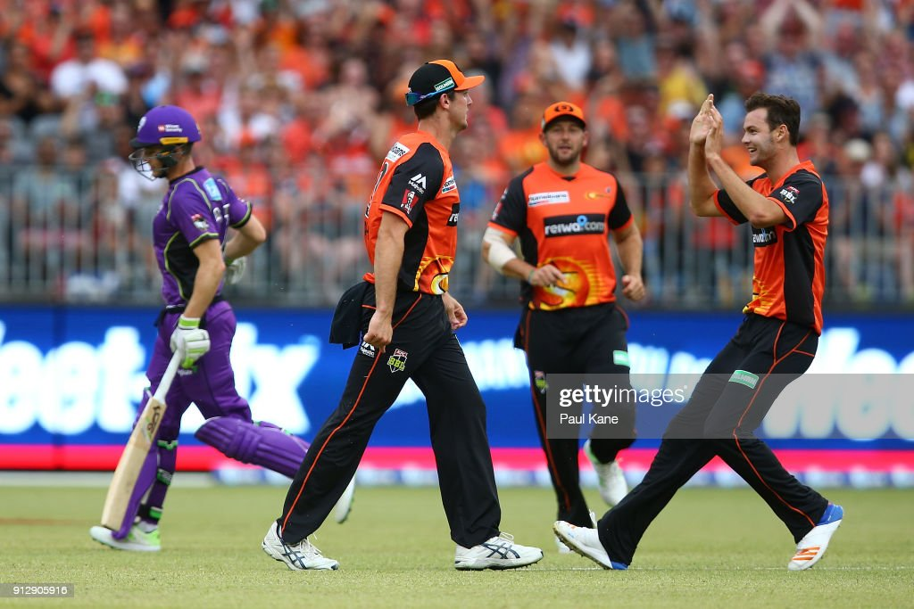 Mitch Marsh and Matthew Kelly of the Scorchers celebrate the dismissal of Tim Paine of the Hurricanes during the Big Bash League Semi Final match between the Perth Scorchers and the Hobart Hurricanes at Optus Stadium on February 1, 2018 in Perth, Australia.