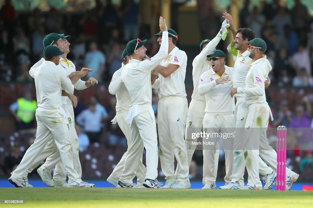 Mitch Marsh and Mitchell Starc of Australia celebrate with their team mates after combining to take the wicket of Joe Root of England during day one of the Fifth Test match in the 2017/18 Ashes Series between Australia and England at Sydney Cricket Ground on January 4, 2018 in Sydney, Australia.