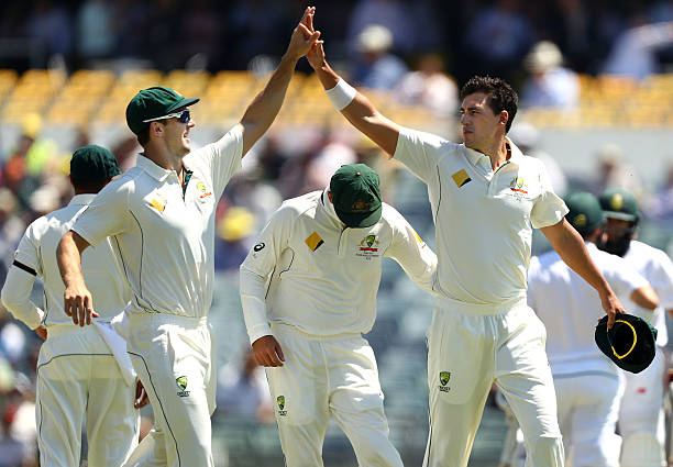 Mitch Marsh and Mitchell Starc of Australia celebrates after Marsh took a catch to dismiss Stephen Cook of South Africa off the bowling of Starc...