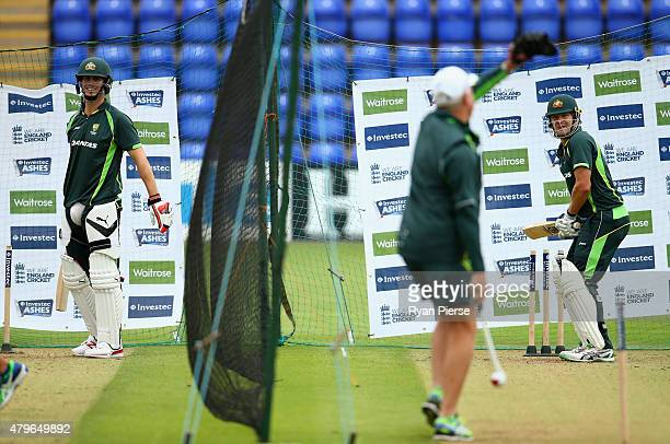 Mitch Marsh and Shane Watson of Australia bat during a nets session ahead of the 1st Investec Ashes Test match between England and Australia at...