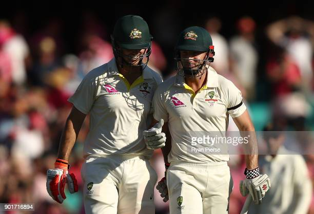 Mitch Marsh and Shaun Marsh of Australia walk from the ground at stumps during day three of the Fifth Test match in the 2017/18 Ashes Series between...