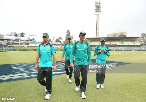 Mitch Marsh Mitchell Starc Josh Hazlewood and Nathan Lyon of Australia walk through the rain as rain delays the start of play during day five of the...