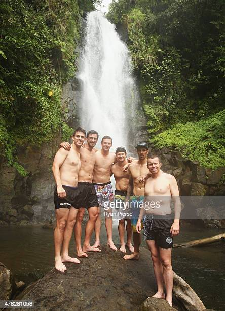 Mitch Marsh Mitchell Starc Josh Hazlewood Shane Watson Mitchell Johnson and Peter Siddle of Australia pose in front of Trafalgar Falls during the...