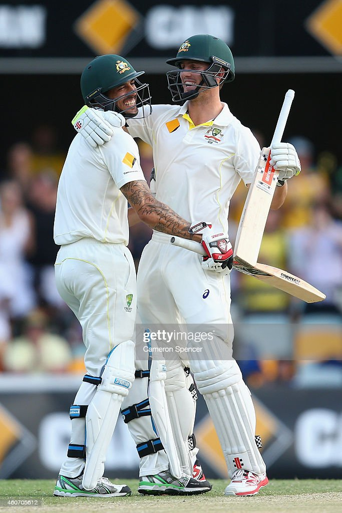 Mitch Marsh of Australia and Mitchell Johnson of Australia embrace as Marsh hits the winning runs to win the test during day four of the 2nd Test match between Australia and India at The Gabba on December 20, 2014 in Brisbane, Australia.