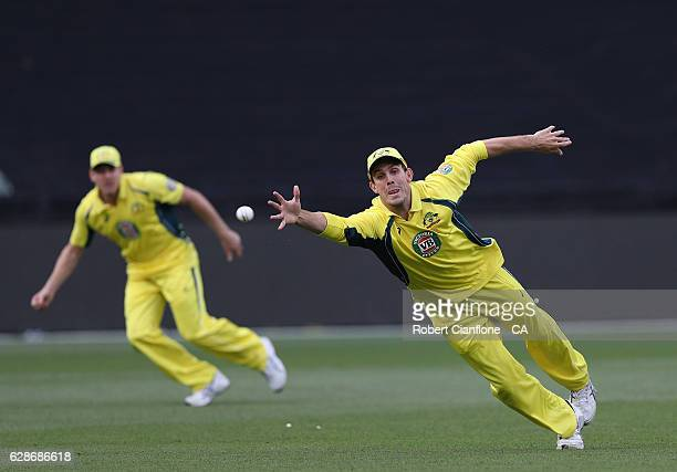 Mitch Marsh of Australia attempts to take a catch during game three of the One Day International series between Australia and New Zealand at...