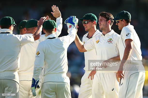 Mitch Marsh of Australia celebrates after dismissing Temba Bavuma of South Africa during day three of the First Test match between Australia and...