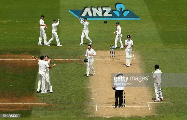 Mitch Marsh of Australia celebrates after he claimed the final wicket of Trent Boult of New Zealand to claim victory during day four of the Test...