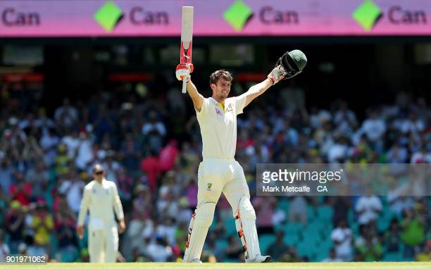 Mitch Marsh of Australia celebrates after scoring a century during day four of the Fifth Test match in the 2017/18 Ashes Series between Australia and...