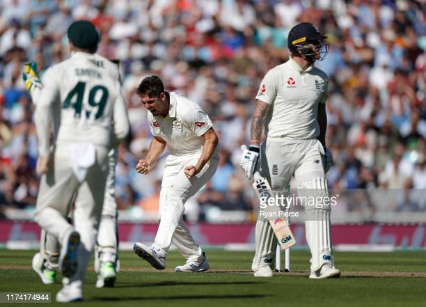 Mitch Marsh of Australia celebrates after taking the wicket of Ben Stokes of England during day one of the 5th Specsavers Ashes Test at The Kia Oval...
