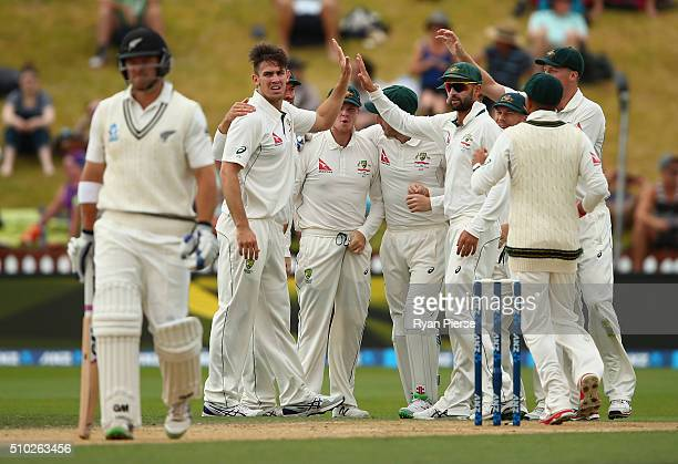 Mitch Marsh of Australia celebrates after taking the wicket of Corey Anderson of New Zealand during day four of the Test match between New Zealand...