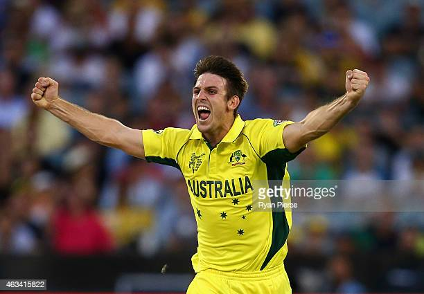 Mitch Marsh of Australia celebrates after taking the wicket of Eoin Morgan of England during the 2015 ICC Cricket World Cup match between England and...