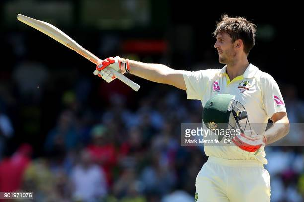 Mitch Marsh of Australia celebrates and acknowledges the crowd after scoring a century during day four of the Fifth Test match in the 2017/18 Ashes...