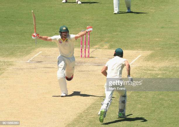 Mitch Marsh of Australia celebrates his century during day four of the Fifth Test match in the 2017/18 Ashes Series between Australia and England at...