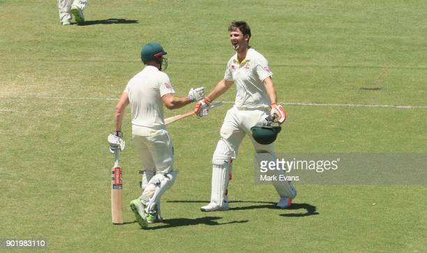 Mitch Marsh of Australia celebrates his century with brother Shaun Marsh during day four of the Fifth Test match in the 2017/18 Ashes Series between...