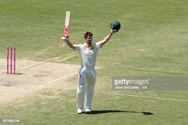 Mitch Marsh of Australia celebrates scoring a century during day four of the Fifth Test match in the 2017/18 Ashes Series between Australia and...
