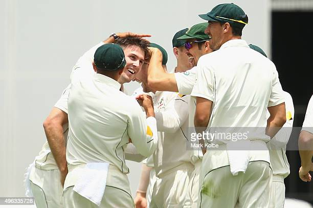 Mitch Marsh of Australia celebrates with his team after taking the wicket of Doug Bracewell of New Zealand during day five of the First Test match...