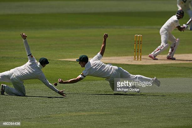 Mitch Marsh of Australia drops a catch next to Steve Smith off an edge from Cheteshwar Pujara of India during day three of the First Test match...