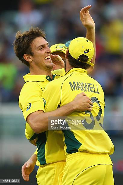 Mitch Marsh of Australia is congratulated by team mates after taking the wicket of Ian Bell of England during the 2015 ICC Cricket World Cup match...