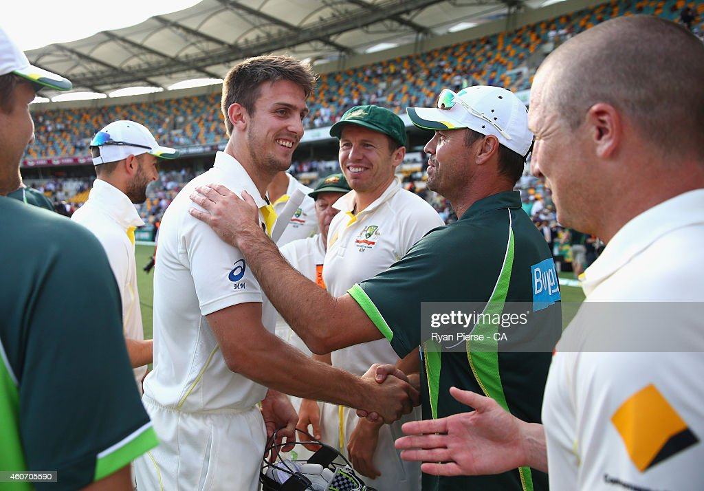 Mitch Marsh of Australia is congraulated by team mates after claiming victory during day four of the 2nd Test match between Australia and India at The Gabba on December 20, 2014 in Brisbane, Australia.