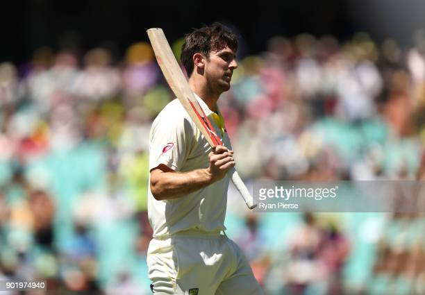 Mitch Marsh of Australia raises his bat as he leaves the ground after being dismissed for 101 runs during day four of the Fifth Test match in the...