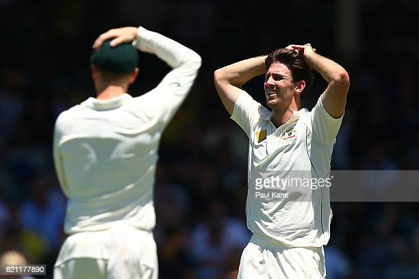 Mitch Marsh of Australia reacts after Dean Elgar of South Africa edged a ball between the keeper and slips to the boundary during day three of the...