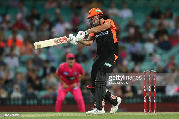 Mitch Marsh of the Scorchers bats during the Big Bash League match between the Sydney Sixers and the Perth Scorchers at the Sydney Cricket Ground on...
