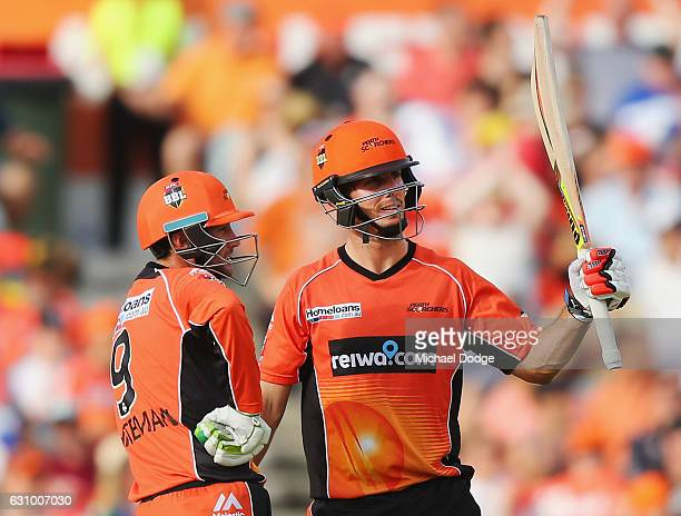 Mitch Marsh of the Scorchers celebrates making a half century during the Big Bash League match between the Perth Scorchers and the Brisbane Heat at...