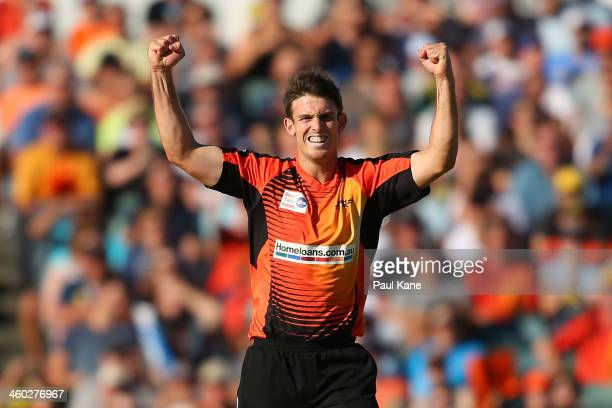 Mitch Marsh of the Scorchers celebrates the wicket of Mike Hussey of the Thunder during the Big Bash League match between the Perth Scorchers and...