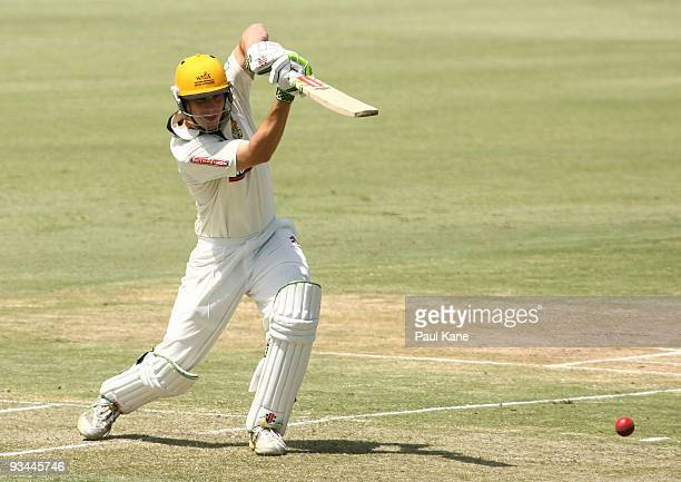 Mitch Marsh of the Warriors drives the ball during day one of the Sheffield Shield match between the Western Australian Warriors and the New South...