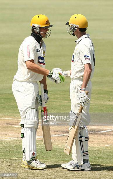 Mitch Marsh of the Warriors is congratulated by Steve Magoffin after scoring his 50 during day one of the Sheffield Shield match between the Western...