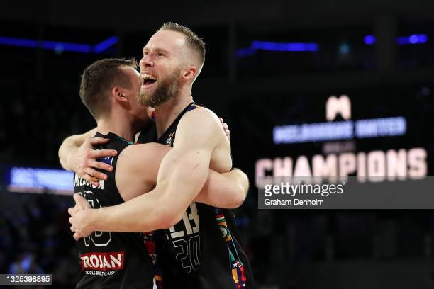 Mitch McCarron and David Barlow of Melbourne United celebrate victory during game three of the NBL Grand Final Series between Melbourne United and...