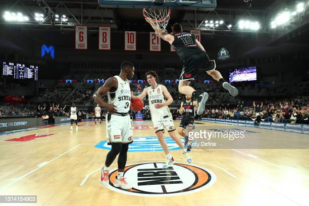 Mitch McCarron of Melbourne United dunks during the round 15 NBL match between Melbourne United and the Adelaide 36ers at John Cain Arena, on April...