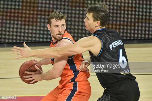 Mitch Mccarron of Taipans completes the ball against Kirk Penney of Breakers during the round six NBL match between the New Zealand Breakers and the...
