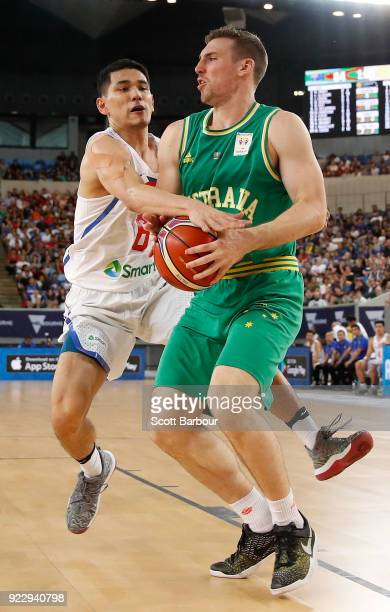 Mitch McCarron of the Boomers controls the ball during the FIBA World Cup Qualifier match between the Australian Boomers and the Philippines at...